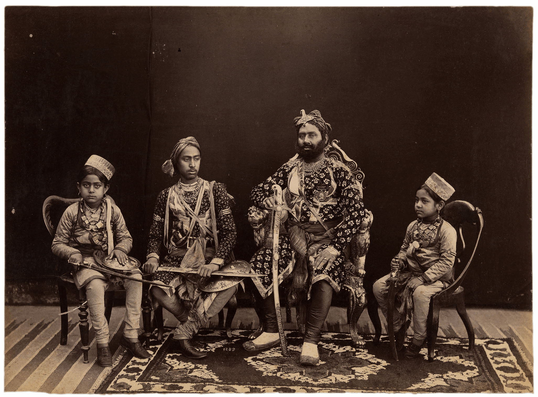 Cat. 17. Raja Deen Dayal. The Maharaja of Ajaigarh with his Three Sons. Bundelkhand, Central India, circa 1882. Albumen print