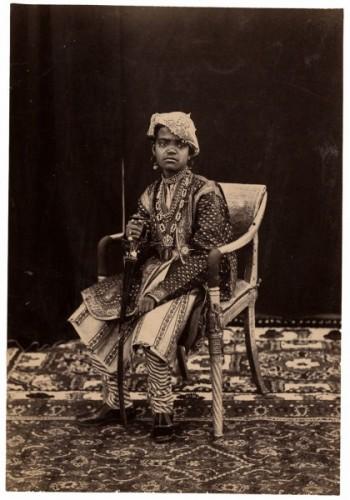 Cat. 19. Raja Deen Dayal. A Young Prince Seated. Bundelkhand, circa 1882. Albumen print, 20 x 13.5 cm