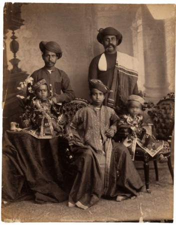 Cat. 21. Raja Deen Dayal. Three Young Princes with Attendants. Indore, Central India, circa 1894. Albumen print 28 x 21.5 cm